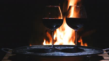 na zdraví : two glasses of wine with flame on background