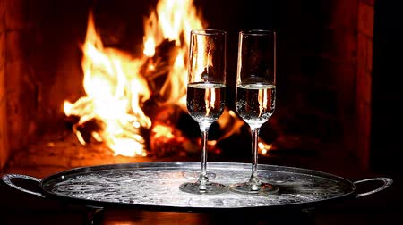 na zdraví : two glasses of chamagne with flame on background