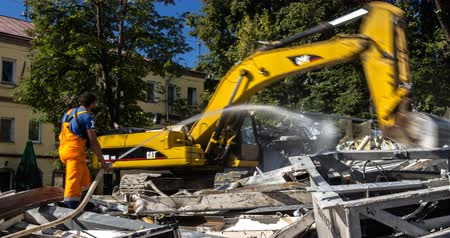 deconstruction : Moscow; Russia, September first-Two thousand sixteen year: working of excavator by demolition of building