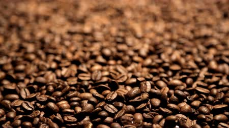 coffee brewing : many coffee beans shot in motion with close-up