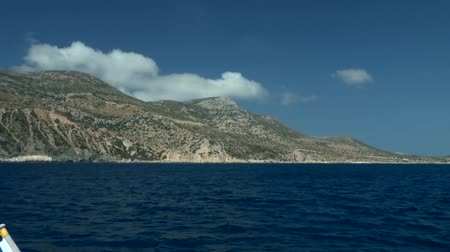 aegean sea : Passing by the shore of one of the Greek islands, Amorgos island, Greece. Stock Footage