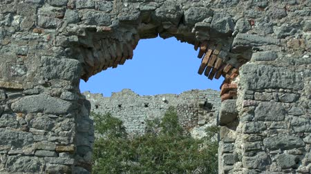 shepherds house : Ruins of an ancient wall on the sky background. The island of Lemnos, Greece. Stock Footage