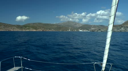 такелаж : View of a Greek seaside town from a sail boat, Amorgos island, Greece.