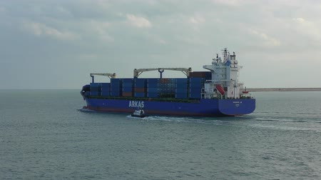 çimenli yol : Container ship leaving the port.