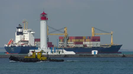 mooring : A large container ship leaves the port.