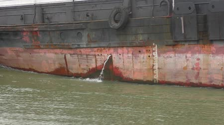 Discharge of waste water from a moving vessel.
