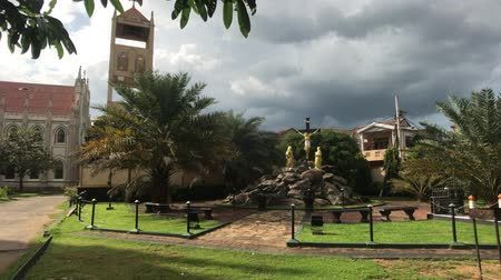 seylan : Negombo, Sri Lanka, November 23, 2019, St. Sebastian Church, territory at the church view from the meadow to the bell tower 4K