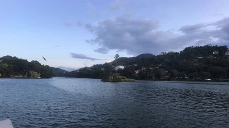 Kandy, Sri Lanka, evening lake from the side of the street and the fence in the temple 4K Stok Video