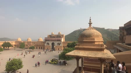 amer fort : Jaipur, India, November 05, 2019, Amer Fort, an area with tourists in a fortress on top of a mountain 4K