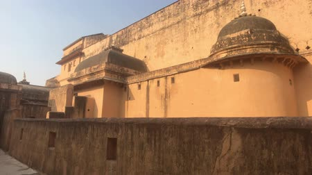 amer fort : Jaipur, India, November 05, 2019, Amer Fort fragment of historic structure of yellow brick 4K
