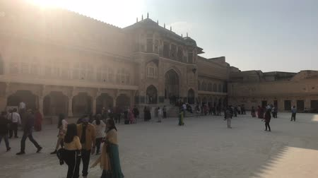amer fort : Jaipur, India, November 05, 2019, Amer Fort tourists in the square stand in the shade of the building 4K Stock Footage