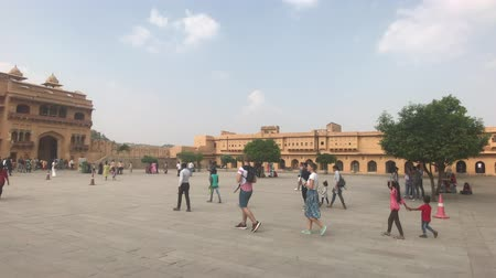 mahal : Jaipur, India, November 05, 2019, Amer Fort, tourists inspect the old buildings around them part 2, 4K