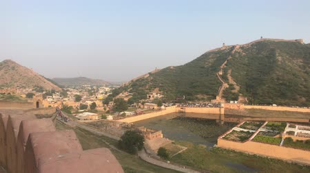 slum : Jaipur, India, November 05, 2019, Amer Fort view of the mountains from the fortress under the sun part 5 4K Stock Footage