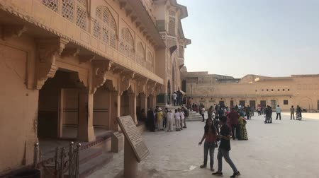 amer fort : Jaipur, India, November 05, 2019, Amer Fort open building with tourists strolling in the shade part 2 4K Stock Footage