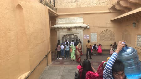 geliştirmek : Jaipur, India, November 05, 2019, Amer Fort, tourists inspect the old buildings around them part 9, 4K