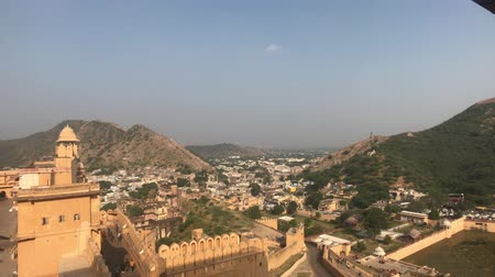 geliştirmek : Jaipur, India, November 05, 2019, Amer Fort, view of the city from the height of the wall in good weather 4K Stok Video