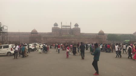 slum : New Delhi, India, November 11, 2019, Red Fort, tourists gather in front of the entrance 4K Stock Footage