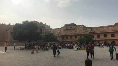 amer fort : Jaipur, India, November 05, 2019, Amer Fort, tourists inspect the old buildings around them 4K