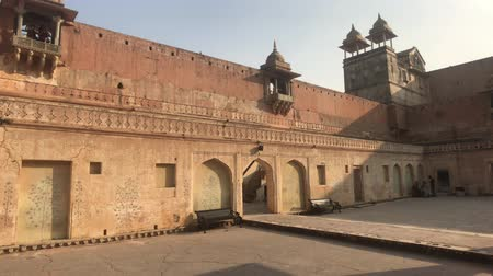 slum : Jaipur, India, November 05, 2019, Amer Fort wall with towers in the courtyard 4K Stock Footage