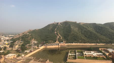 amer fort : Jaipur, India, November 05, 2019, Amer Fort view from the height of the fortress on a mountain with another fortress 4K