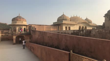 geliştirmek : Jaipur, India, November 05, 2019 Amer Fort tourists walk on different levels of the fortress part 6 4K