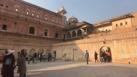 amer fort : Jaipur, India, November 05, 2019, Amer Fort tourists stroll through the premises of the old fortress 4K