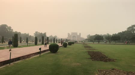 astroloji : Agra, India, November 10, 2019, Taj Mahal, an alley with bushes on the way to the mosque 4K