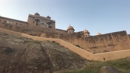 slum : Jaipur, India, November 05, 2019, Amer Fort, view from below of the beautiful fort structure 4K