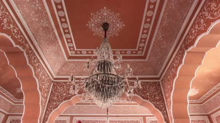 mahal : Jaipur, India - City Palace is a beautiful large chandelier against a rose ceiling 4K Stock Footage