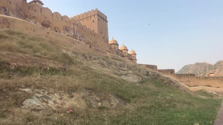 amer fort : Jaipur, India, November 05, 2019, Amer Fort view of the watchtowers below the fortress 4K