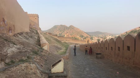 amer fort : Jaipur, India, November 05, 2019, Amer Fort tourists descend the old streets of the fort part 3 4K
