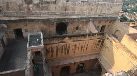 slum : Jaipur, India, November 05, 2019, Amer Fort tourists are looking for a way out of the labyrinth of corridors 4K