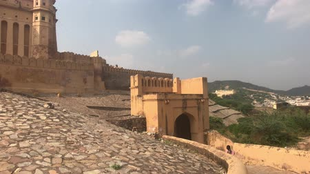 amer fort : Jaipur, India, November 05, 2019, Amer Fort, a piece of road inside the fortress with a fleeing tourist 4K