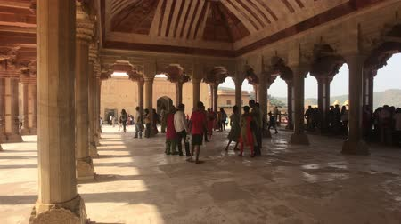 купол : Jaipur, India, November 05, 2019, Amer Fort tourists hid from the scorching sun under a canopy 4K Стоковые видеозаписи