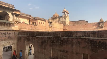 amer fort : Jaipur, India, November 05, 2019, Amer Fort tourists walk on different levels of the fortress 4K Stock Footage