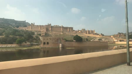 amer fort : Jaipur, India, November 05, 2019 Amer Fort historic fortress wall overlooking transport 4K