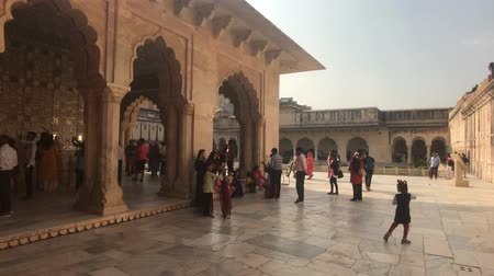 amer fort : Jaipur, India, November 05, 2019, Amer Fort open building with tourists strolling in the shade 4K
