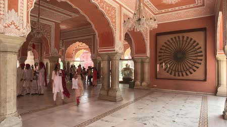 slum : Jaipur, India - November 04, 2019: City Palace tourists walk past the walls of a pink building part 2 4K Stock Footage