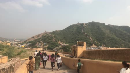 slum : Jaipur, India, November 05, 2019, Amer Fort, tourists move down the street of the old town in the fortress 4K Stock Footage