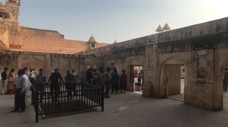 amer fort : Jaipur, India, November 05, 2019 Amer Fort tourists walk on different levels of the fortress part 7 4K