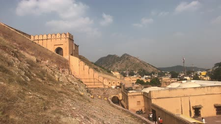 amer fort : Jaipur, India, November 05, 2019, Amer Fort, tourists examine the historic fragments of the fort part 2, 4K