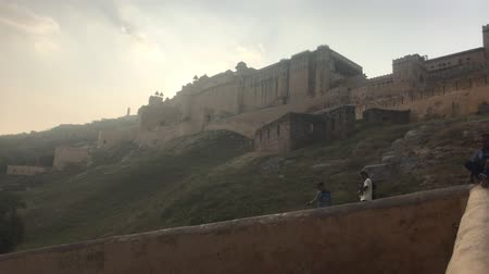 amer fort : Jaipur, India, November 05, 2019, Amer Fort, tourists sit waiting for the opening of the work of the fort 4K