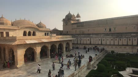 amer fort : Jaipur, India, November 05, 2019, Amer Fort tourists stroll through the premises of the old fortress part 4 4K Stock Footage