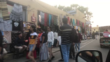 Дели : Jaipur, India - November 03, 2019: a street with tourists and lots of motorcycles part 3 4K Стоковые видеозаписи