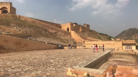 amer fort : Jaipur, India, November 05, 2019, Amer Fort, tourists examine the historic fragments of the fort 4K