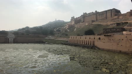 amer fort : Jaipur, India, November 05, 2019, Amer Fort, not a large lake under the walls of the grand fort 4K