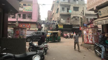 slum : New Delhi, India, November 11, 2019, street crowded with traffic and tourists 4K