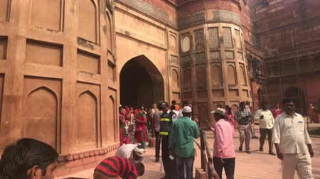 slum : Agra, India, November 10, 2019, Agra Fort, a stream of tourists moves to the territory of the fort 4K