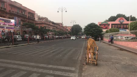 geliştirmek : Jaipur, India - November 03, 2019: motorbike traffic along the road with tourists part 13 4K