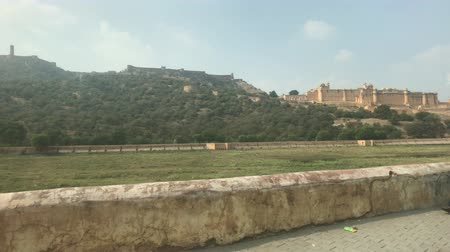 amer fort : Jaipur, India, November 05, 2019, Amer Fort, traffic to meet tourists against the backdrop of mountains 4K